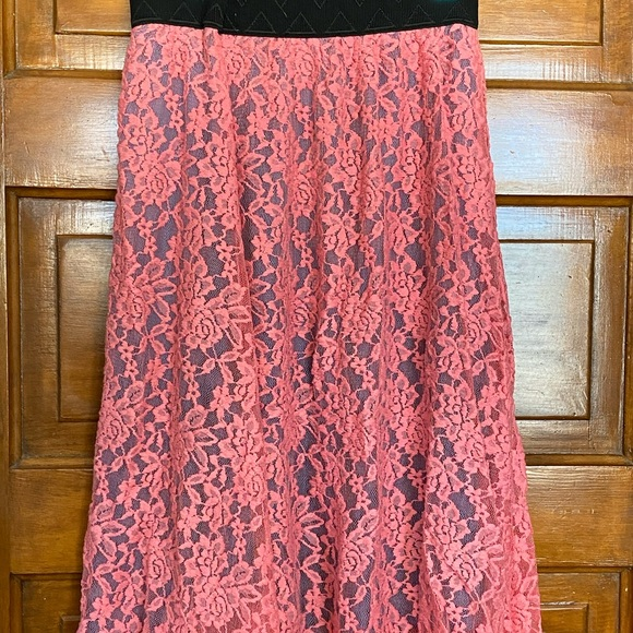 Rose colored lace Lola over a dusty blue skirt.